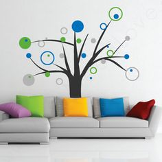Rings and Dots Tree Wall Decal behind the couch