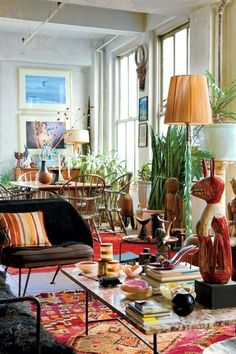 A tribal rug complements earthy tones and green plants.   - HarpersBAZAAR.com