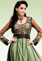 Ultimate collection of embroidered suits with fabulous style. The dazzling black and pastel green net churidar suit have amazing embroidery patch work is done with resham, sequins and lace work. The entire ensemble makes an excellent wear. Matching black santoon churidar and pastel green faux georgette dupatta is available with this suit. Slight Color variations are possible due to differing screen and photograph resolutions.
