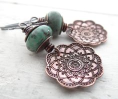 Copper and Turquoise Flower Drops // etched flowers with African turquoise beads on sterling silver ear hooks // artisan bohemian (2541) on Etsy, $25.00