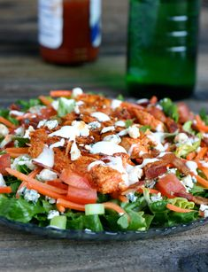 buffalo chicken salad, saute chicken in hot sauce and yogurt/sourcream/ or ranch, add tomatoes, cheese, cucumbers