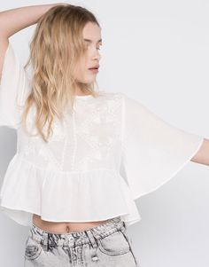 :BELLED SLEEVE TOP WITH EMBROIDERY AT CHEST
