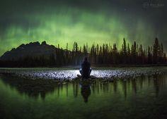 Dancing lights over Cascade Mountain, Banff National Park. Photo by Paul Zizka Photography.