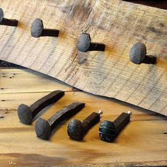 ▬ DESCRIPTION This listing is for one (1) hook. Old iron railroad spikes made into hooks, naturally rusted and weathered, optional varnish finish. We cut, drill and tap each spike by hand. Screw included to anchor hook to wood or other board materials.The uses for these railroad spike hooks are endless, great for adding a rustic or industrial touch to furniture or other projects. For railroad spike hanger bolt that can be screwed directly into the wall, please see our Railroad Spike Hooks…