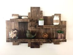 Rustic wall shelf, reclaimed wood wall shelf, pallet shelf, floating shelf, wood wall art, rustic decor, farmhouse decor, pallet furniture by NorthernOaksDecorCo on Etsy https://www.etsy.com/listing/523708435/rustic-wall-shelf-reclaimed-wood-wall