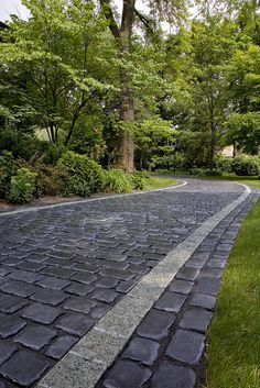 This driveway needs to be in front of my house! Courtstone driveway with Unigranite inset by Unilock North America, via Flickr