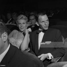 Singer and actor Frank Sinatra and actress Kim Novak attend the premiere of 'The Desperate Hours' on October 10, 1955 in Los Angeles, California.
