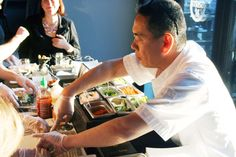Sushi chef Kaz Okochi helps a student roll her inside-out roll. (Photo: Mark Heckathorn/DC on Heels)