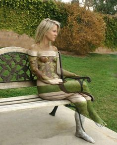 Body painting, woman on a bench.