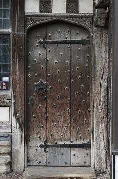 This Shakespeare Door is a beautiful historic door found on the childhood home of Shakespeare in Stratford Upon Avon, in southwest England. Its a beautiful old door full of so much history and made of such amazing craftsmanship! This photo would make a great addition to any