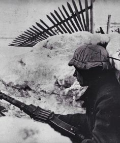 Lonely vigil: German machine gunner on the Eastern Front at his post ready for the enemy.