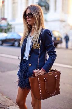 Erica Pelosini in a blue blazer + white tee + ostrich feather miniskirt + tan Valentino tote