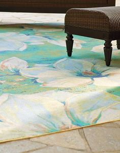Splash vibrant color and beautiful florals across your outdoor space with the Magnolia Outdoor Area Rug; available in an array of sizes to suit any space.