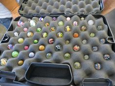 """This is a case of handmade marbles dating 1850's - 1915 or so. In this case you see a variety of Swirls, Clambroths, Latticinos, and Lutz marbles. For example, the top left marble that is red, white, and blue is a """"Peppermint Swirl"""" marble. The marbles that have an opaque base with fines lines are the """"Clambroths"""", with multi color lines are """"Latticino"""".  And, those that have sparkly gold bands are called, """"Lutz"""" marbles named after the guy that first used the sparkly glass referred to as…"""