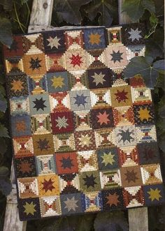 Courthouse Steps plus Variable Star mane a cool secondary design.  Quilt by Country Threads.