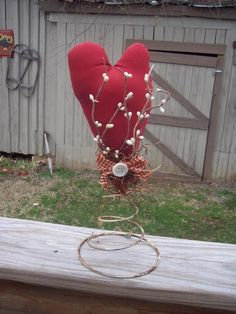 Primitive Heart Nodder   My handmade Primitive Heart Nodder is grundged with my own tea and cinnamon recipe. It sits on a antique rusty spring. Adorned with homespun ribbon, button and white pip berries. Great for Valentine's Day or everyday decor!  https://www.facebook.com/pages/Yellow-House-Primitives/359850087368484