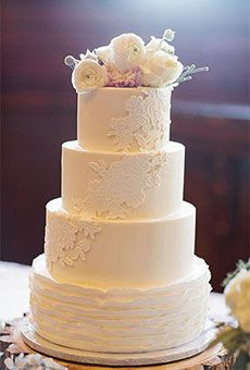 Four-Tier Wedding Cake with Ruffled Bottom Tier and Lace Appliques | Wedding Cake