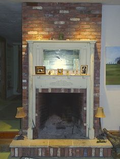 Fireplace that we did for an amazing woman and artist.  The hearth stone that we used was I believe from Egypt and it was covered in fossils.  We also used again the reclaimed factory brick from an old mill in Mass.