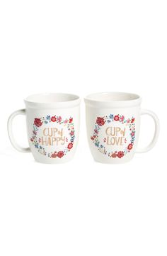 A glossy 'Cup of Happy' mug pairs with a coordinating 'Cup of Love' counterpart packaged together in a cute box set for easy, charming gifting.