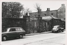 Great photo of boundary of Fever Hospital on Cork Street showing gates & lodge with pub and housing on corner with Donore Avenue from Paddy Healy collection 1964-67 in Irish Architectural Archives