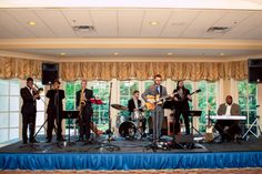 A #liveband really makes a #weddingreception come alive! The #EmeraldEmpireBand, shown here, did such a great job getting everyone on the #dancefloor! ::Garland + Jordy's gorgeous outdoor lake wedding at the Chatahoochee Country Club in Gainesville, Georgia:: #weddingbands #georgiabands #georgiawedding #weddingphotography #reception