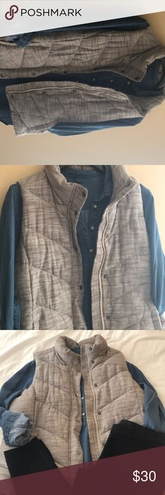 GAP Puffy Vest Puffy vest from the GAP. Bright and brown design, grey colored buttons, with a beige lining inside. Size XL, fits comfortably over sweaters and jackets. Vest has only been worn once; no holes, rips, or pilling. Great with a chambray button up , leggings, and booties! GAP Jackets & Coats Vests