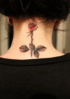 Single rose tattoo on neck