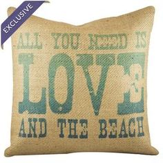 "Handmade burlap pillow exclusive to Joss & Main. Print reads ""All you need is love and the beach.""   Product: PillowConstruction Material: 100% BurlapColor: Beige and turquoiseFeatures:  Handmade by TheWatsonShopZipper enclosure Insert includedMade in the USA Dimensions: 16"" x 16""Cleaning and Care: Spot clean only"