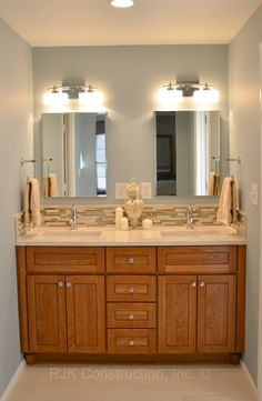 A Master Bath By RJK. Tons Of Storage, Soothing Tones And Glass Accents  Create A Gorgeous Vanity For Two. The Vanity By Bertch Bath Cabinetry Was  Designed ...