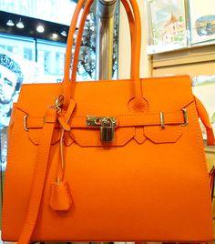 Orange leather Birkin style handbag.