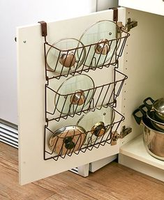 Storage cabinet pots and pans storage tools. I love this post so much! It seriously helped me so much! I live in a tiny place so I need to use every space so wisely! This guide gave me so many ideas and a lot of ways to think differently that I never thought about before. These simple home hacks for storage is amazing!! Pinning for later!