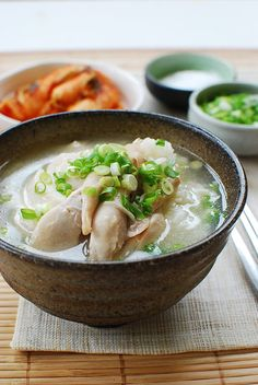 Dak Gomtang (Korean Chicken Soup)  Ingredients:  1 whole chicken (3 - 4 pounds)  10 - 12 garlic cloves  1 small piece ginger  1/2 medium onion  2 - 3 scallion white parts  1/2 teaspoon whole black peppers (optional)    10 cups of water    3 scallions, finely chopped to garnish  salt and pepper to taste