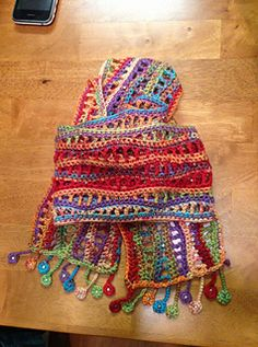 "I took the pattern and <span class=""best-highlight"">turned it vertical, added</span> beads, and made funky fringe. It came out GREAT and I get lots of compliments. It blocked well an..."