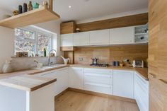 The client had shown us a single image from Pinterest of a Scandinavian Kitchen. The theme as you can see is raw oak and clean white.