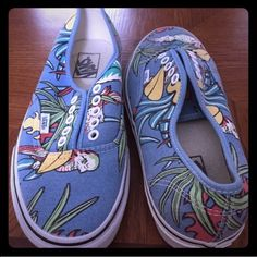 Parrot Blue Vans This is a pair of gently worn Vans. They are blue with a tropical parrot print all over. The size is a men's 7.5/women's 9. There are no laces included. Vans Shoes