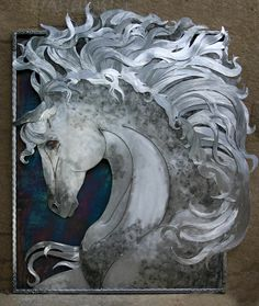 Steel metal art created with hand cut pieces arranged in a fine art fashion and colored either with heat or steel patinas. Framed in metal or organic edges finish