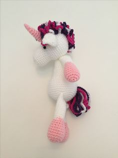 Crochet unicorn, made using the horse and highland cow patterns from the book Edwards menagerie by Kerry Lord. Found the instructions for this on Tofts website