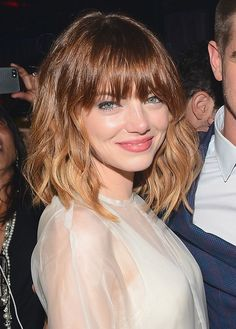 Loving the choppy bangs and waves.  Emma Stone Spider-Man 2 premiere after-party hair makeup