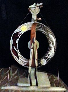 My spinning wheel. A Kromski Fantasia painted with a scene depicting Hati and Skol chasing the sun and the moon. A Norse myth of the end of the world. Spinning Wool, Hand Spinning, Spinning Wheels, Weaving Tools, Loom Weaving, Spin Me Right Round, Drop Spindle, Yarn Inspiration, Yarn Tail