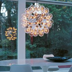 Taraxacum 88 S: Discover the Flos suspended lamp model Taraxacum 88 S FLOS Lights available at http://www.limeshowrooms.co.uk/news/