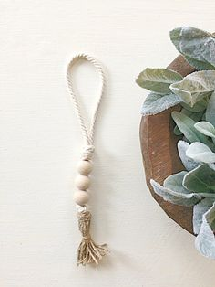 Hello and thank you for stopping by jars of clay co.! This natural wood bead loop cord garland with twine tassel is a perfect finishing accent to your home decor! This new and different item has been popping up all over home decor photos recently and gives a rustic charm to all kinds of home styles. From farmhouse, to shabby chic, to French country, this garland is sure to bring just the perfect touch to complete you vignette, fire mantel, or centerpiece! Hang it on door knobs, vases…