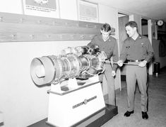 Cadets at the U.S. Military Academy examine a model of a jet engine - PICRYL Public Domain Image
