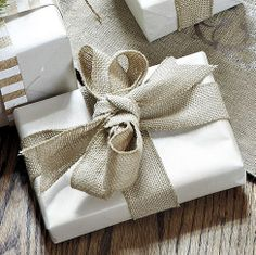 Add texture to your gift wrapping by using burlap ribbon to a simply wrapped gift. #giftwrapping #elegant