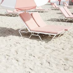 pink lounge chairs on the beach with our names on them