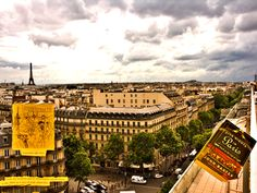 """Good read about Paris: Five Nights in Paris by John Baxter, """"From the moment Baron Haussmann rebuilt Paris in the 1860s as a city of wide sidewalks … ."""" And to go with the book, here's an excellent place to view Paris, the rooftop of Printemps, looking down on the Baron's Boulevard, Boulevard Haussmann, of course, at Rue Tronchet."""