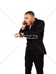 young businessman shouting while talking on cellphone. - Young businessman shouting while talking on cellphone against white background, Model: Kareem Duhaney