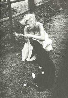 marilyn monroe with her dog, hugo, 1957 • sam shaw