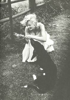marilyn monroe with her dog, hugo, 1957 • sam shaw