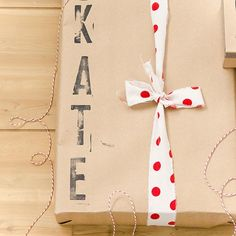 Custom Kraft paper gift wrapping project. The name stamped on is great just use a better ribbon