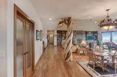 Great room - Be sure to notice the preserved interior tree! - New custom home designed and built by Quail Homes of Vancouver Washington.